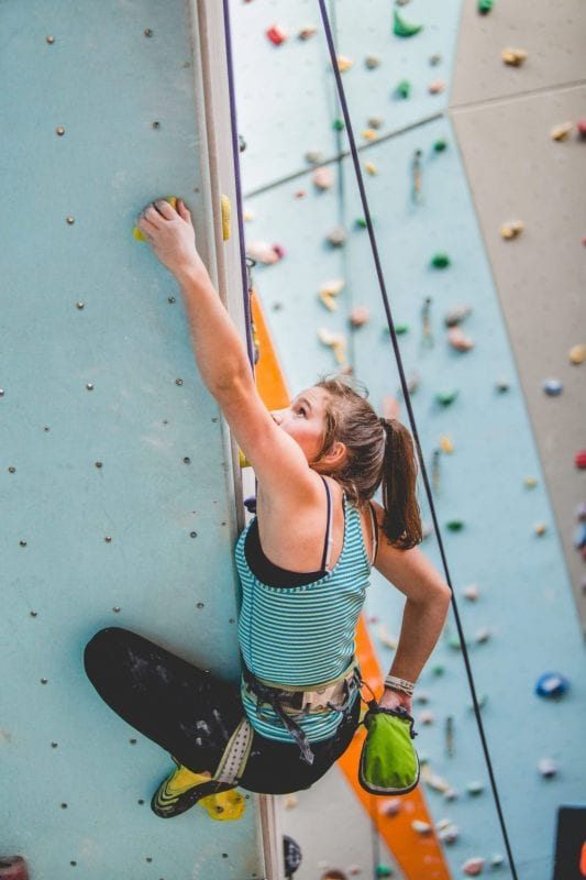 climber on internal climbing wall